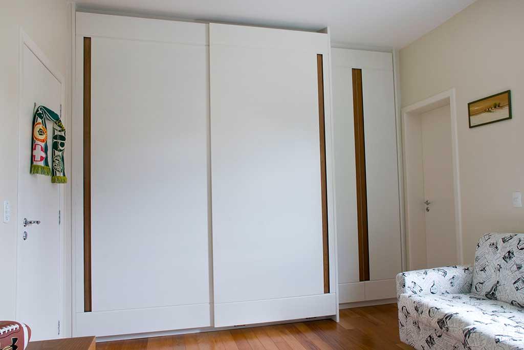 armario sob medida em laca branca guarda roupa sob medida armario porta de correr  unimoveis marcenaria boutique projetos completos acabamentos importados da europa e atendimento alto padrão armário para quarto sob medida